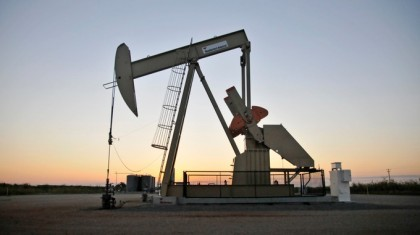 Oil price briefly falls below $30 a barrel